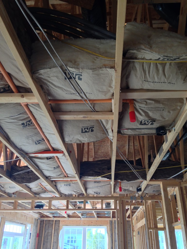 large blocks of insulation sitting on wooden beams for future ceiling