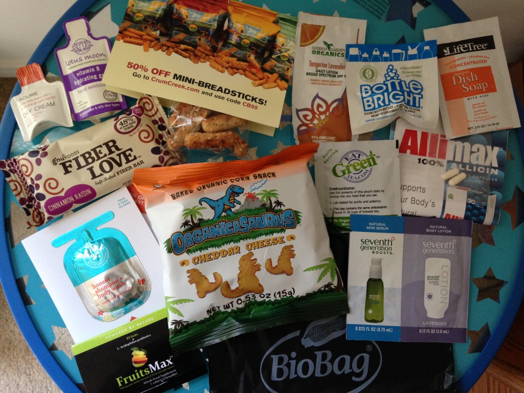 conscious box october contents including acure day cream, lotus moon facial moisturizer, crumcreek mini breadsticks, goddess garden daily lotion, bottle bright cleaning tablet, lifetree dish soap, gnu foods fiber bar, eat green tea supplement, allimax capsules, honest shampoo + body wash, organicasaurus baked corn snacks, seventh generation serum and body lotion, fruitsmax supplement tablets, and biobag