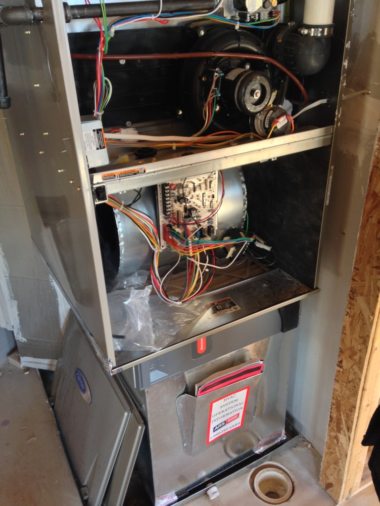 open hvac box with wiring and piping