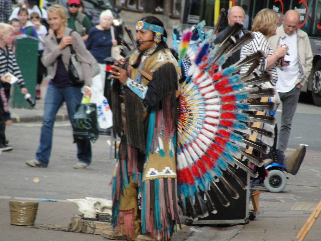 native american street performer playing music