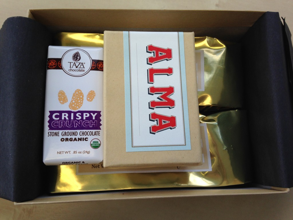 treatsie october box contents with chocolates, chocolate bar, and toffee