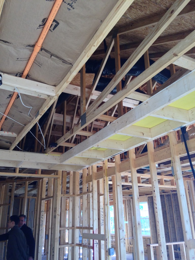 wooden beams for framework of walls and ceiling of condo under construction