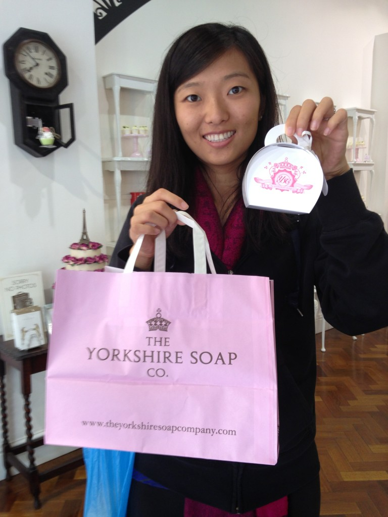 holding up yorkshire soap co shopping bag and cute paper box