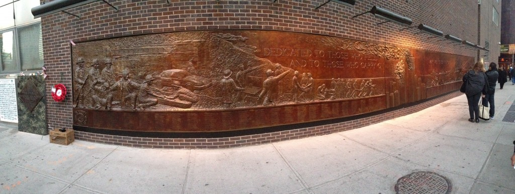 panoramic of 9/11 memorial mural along new york city sidewalk
