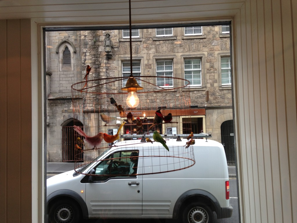 cute bird cage-themed light frame hanging in mimi's bakehouse in edinburgh