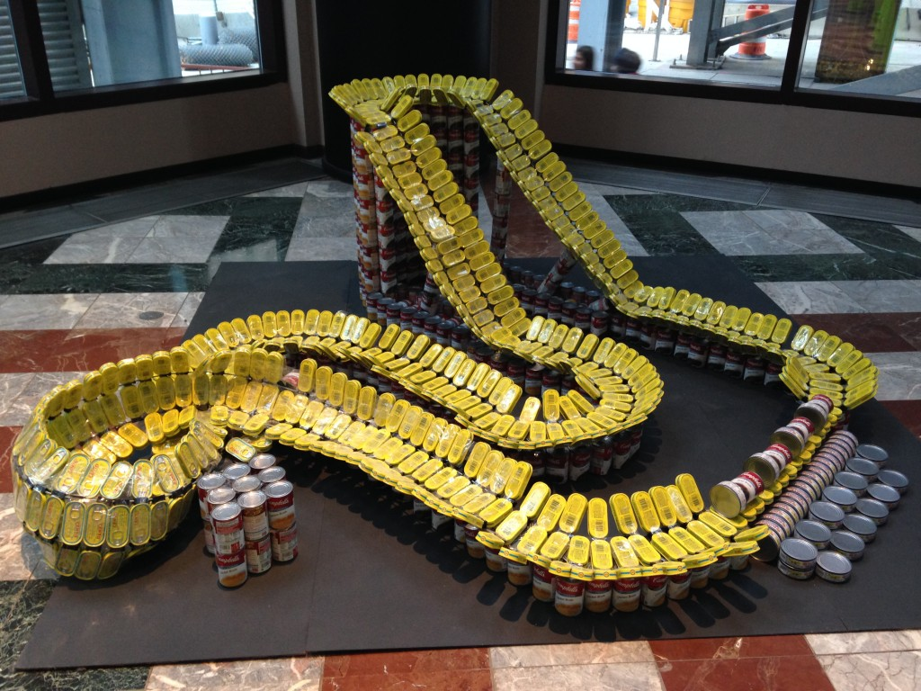 canstruction rollercoaster sculpture made of cans