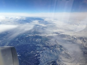 flying over colorado mountains covered in snow