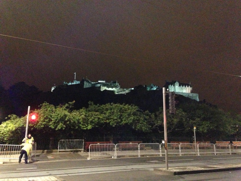 view of edinburgh castle at night from princes street