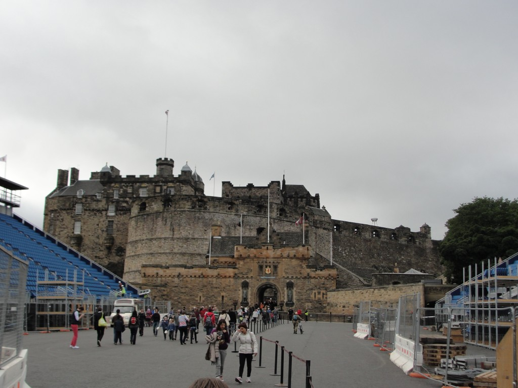 entrance to edinburgh castle atop hill with temporary bleachers set up