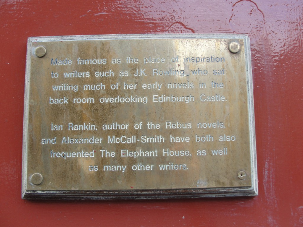 plaque detailing the elephant house in edinburgh's history of inspiring authors like jk rowling, ian rankin, and alexander mccall-smith