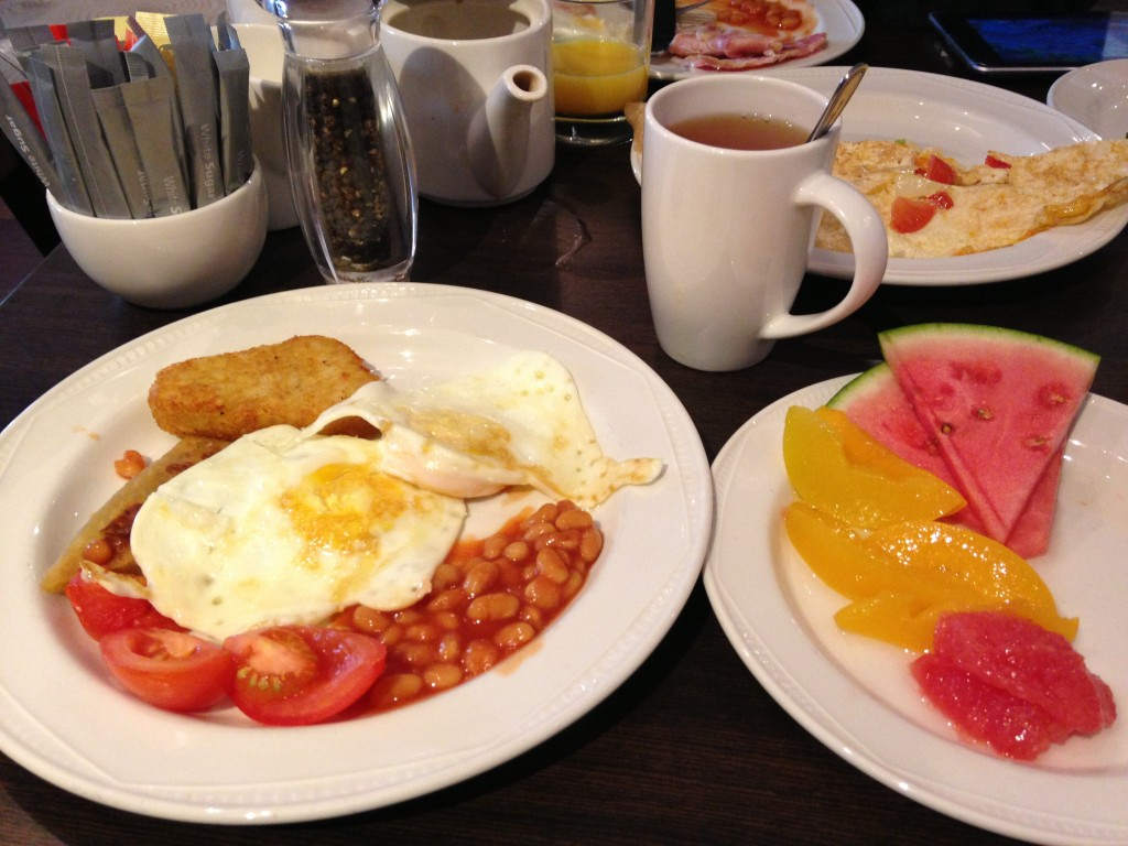 english breakfast at hilton edinburgh with fried eggs, baked beans, tomatoes, hash browns, tea, omelette, and fruit