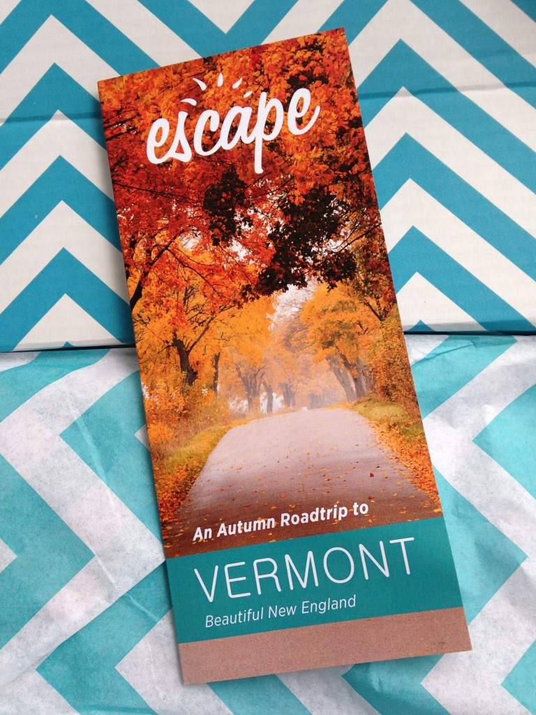 escape monthly november vermont box info card against blue and white chevron background