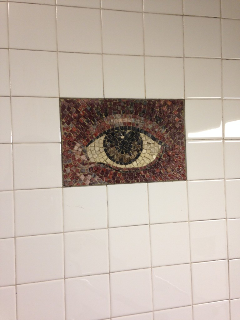 eye mosaic on subway station wall