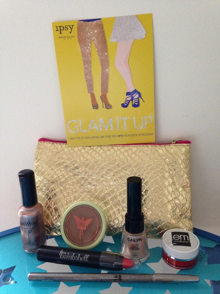 ipsy november 2013 bag items with card including nailtini lacquer in champagne, pixi beauty bronzer in summertime, cailyn mineral eyeshadow in champagne, em michelle phan pillow plush lip balm in strawberry, be a bombshell lip crayon in hot da*n, and starlooks gem pencil in amethyst