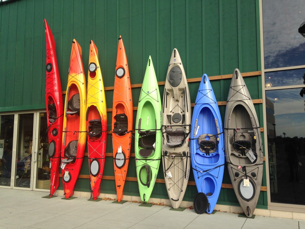 colorful kayaks lined up outside ll bean store