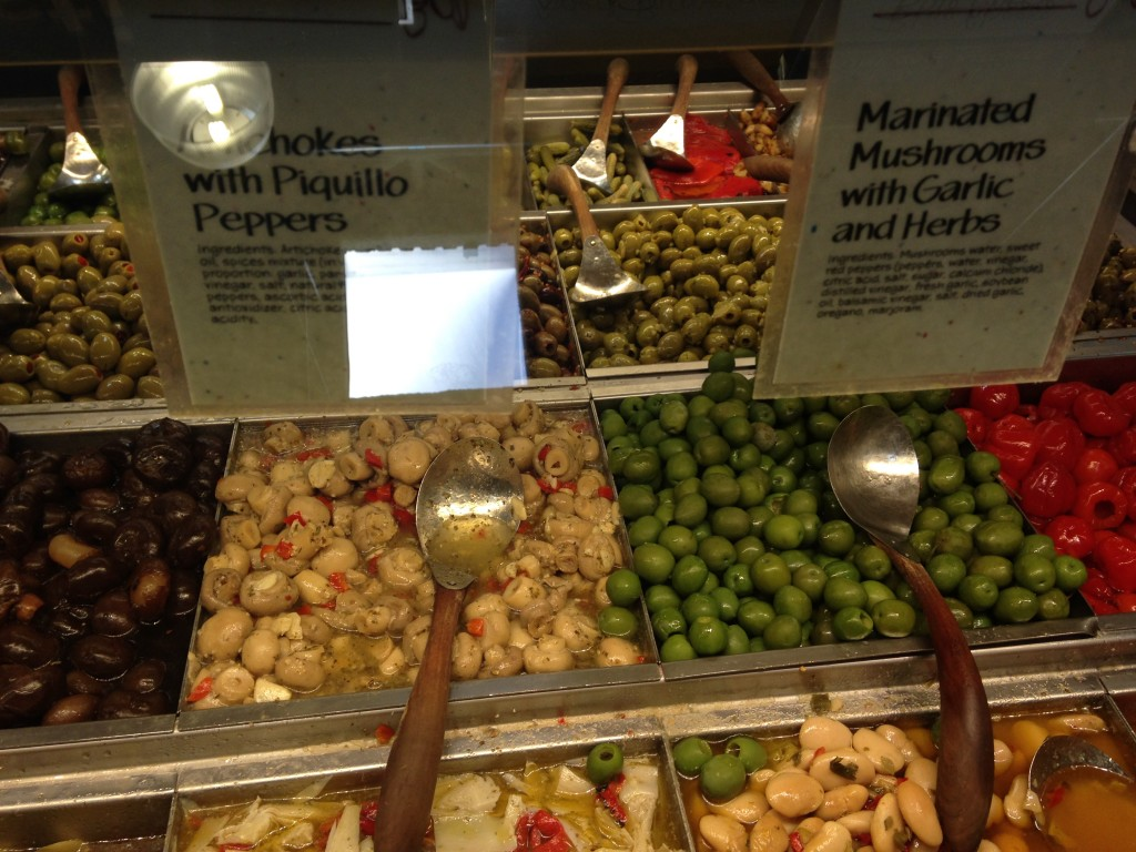 marinated mushrooms with garlic and herbs at olive bar in whole foods