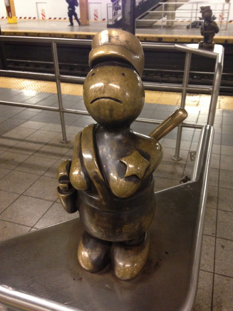 metal cartoonish statue in subway station