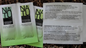 collage of natu liberating shampoo and reawakening conditioner samples included in april 2013 blissmobox