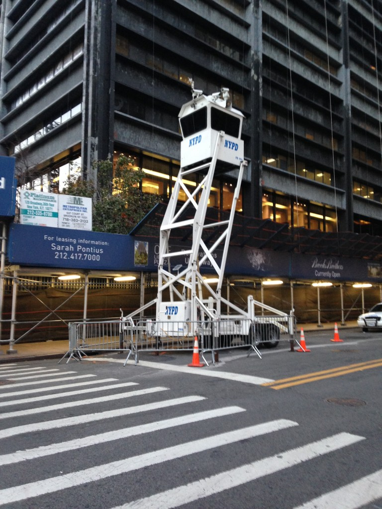 nypd raised viewing cube higher than second story of building