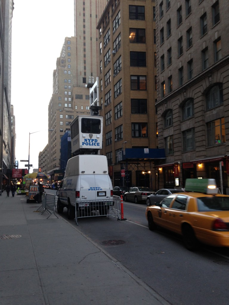 nypd police truck with viewing unit sitting atop it