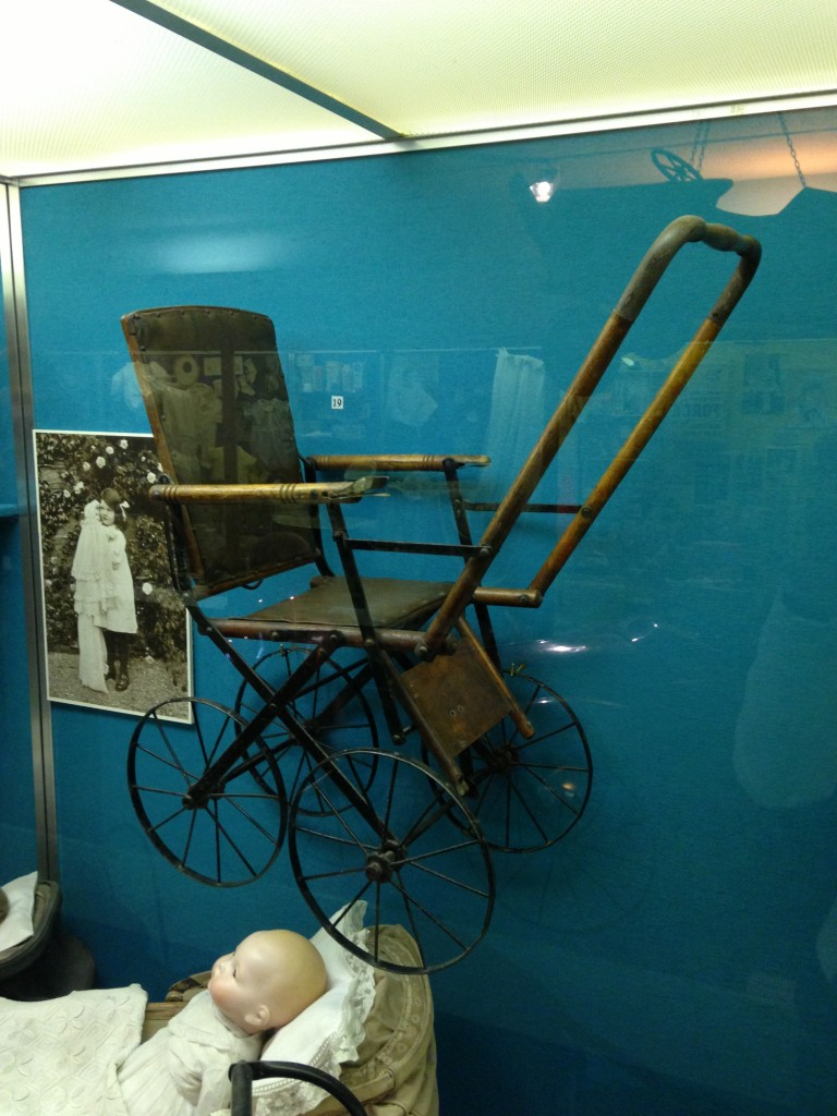 old stroller from long ago in museum of childhood in edinburgh