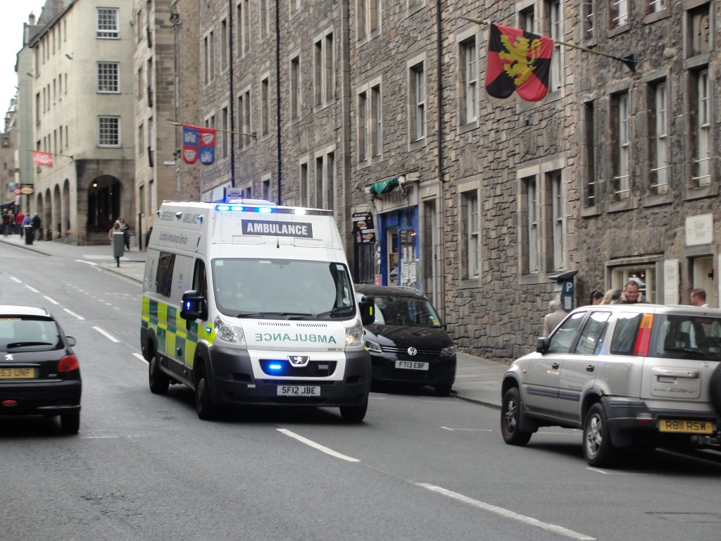 scottish ambulance driving down road in edinburgh