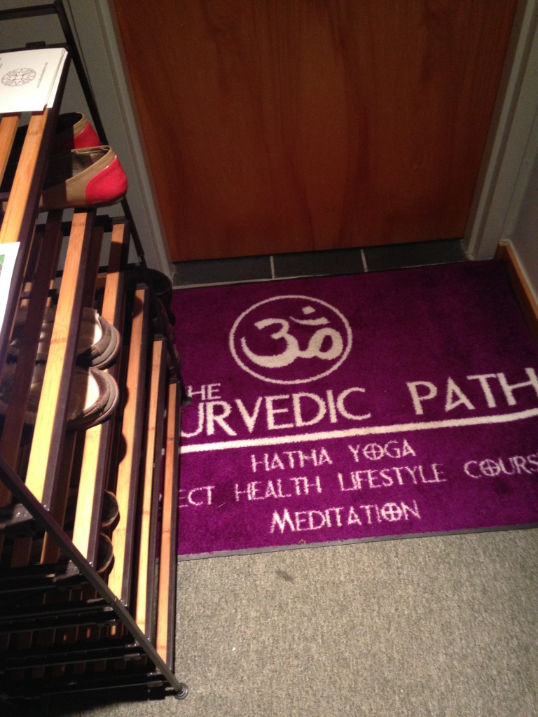 floor of the ayurvedic path entrance with welcome mat and shoe rack