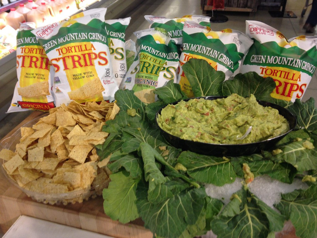 free samples of tortilla strips and guacamole dip at whole foods