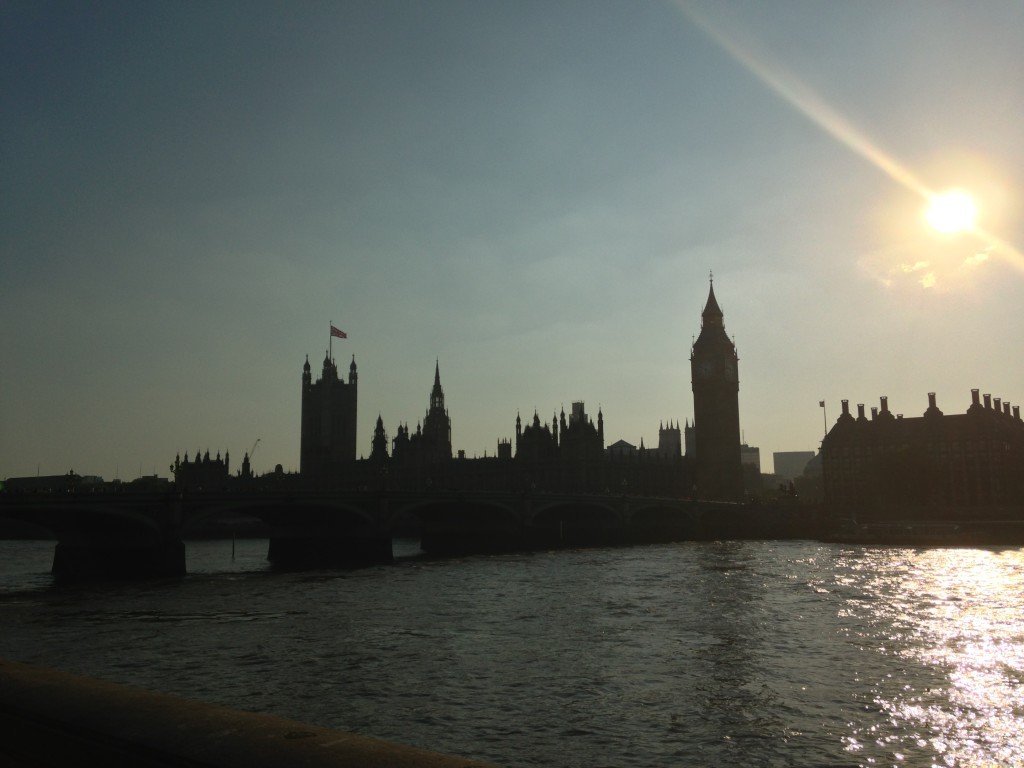 silhouette view of british parliament building across river thames