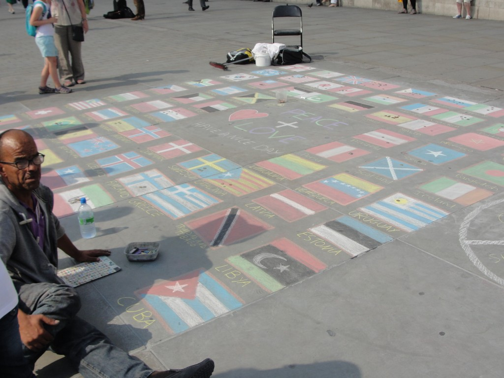 chalk drawings of international flags on plaza at trafalgar square