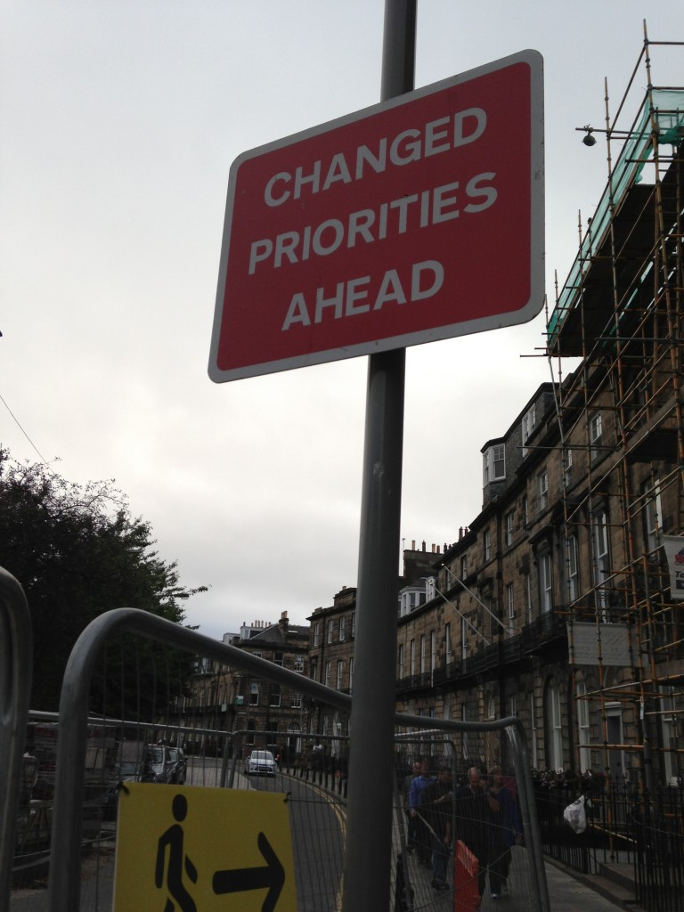 red and white changed priorities ahead sign in edinburgh