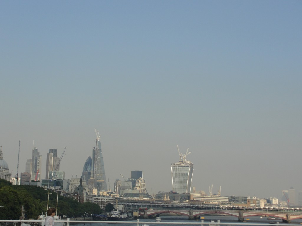 view of eastern london buildings from waterloo bridge