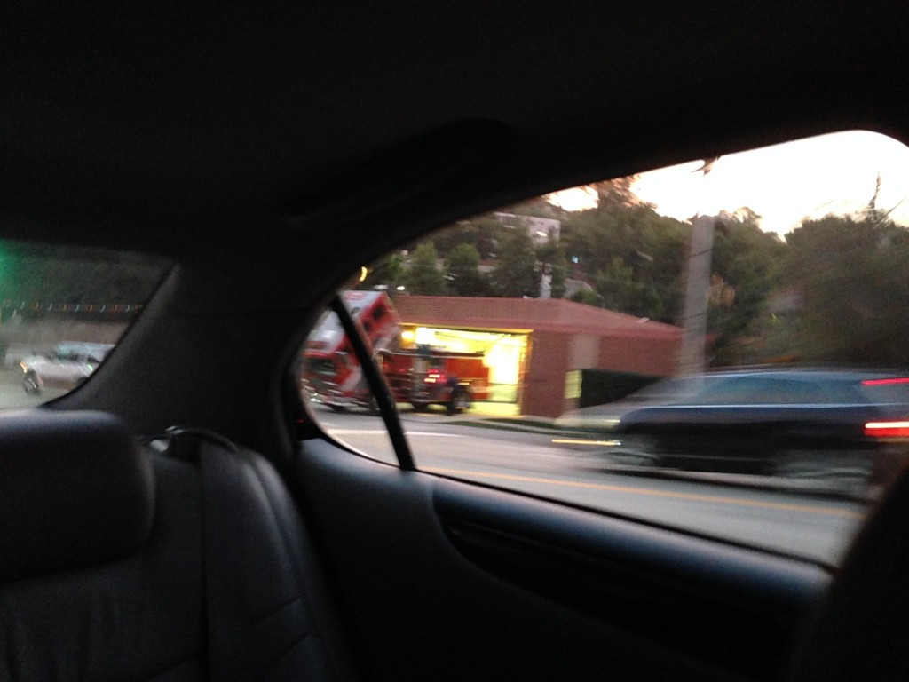 blurry image of firetruck with front part tilted open