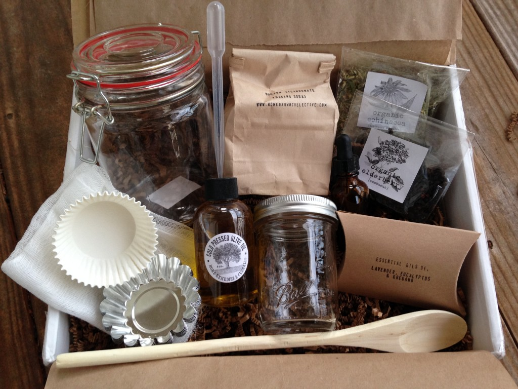 contents of the homegrown collective december 2013 box with naturally essential home remedies and cure-alls theme