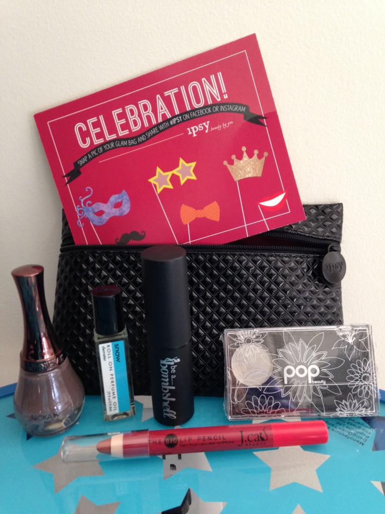 ipsy december 2013 bag items with card including nicka k new york nail color in classic taupe, demeter roll on perfume oil in snow, be a bombshell the one stick in flustered, pop beauty eye shadow trio in smokin' hot, and j.cat beauty big lip pencil in caramel mocha