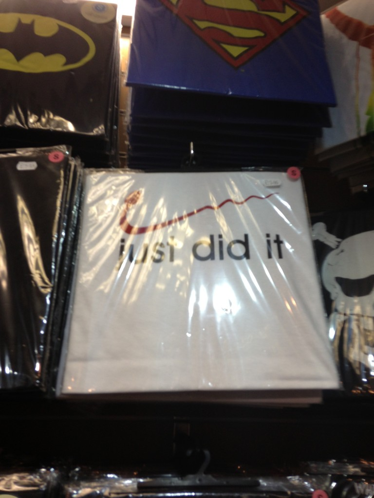"t-shirt with sperm in place of nike logo and ""just did it"" messaging"