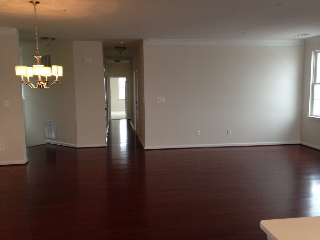 large open space of living and dining room with cherry hardwood floors