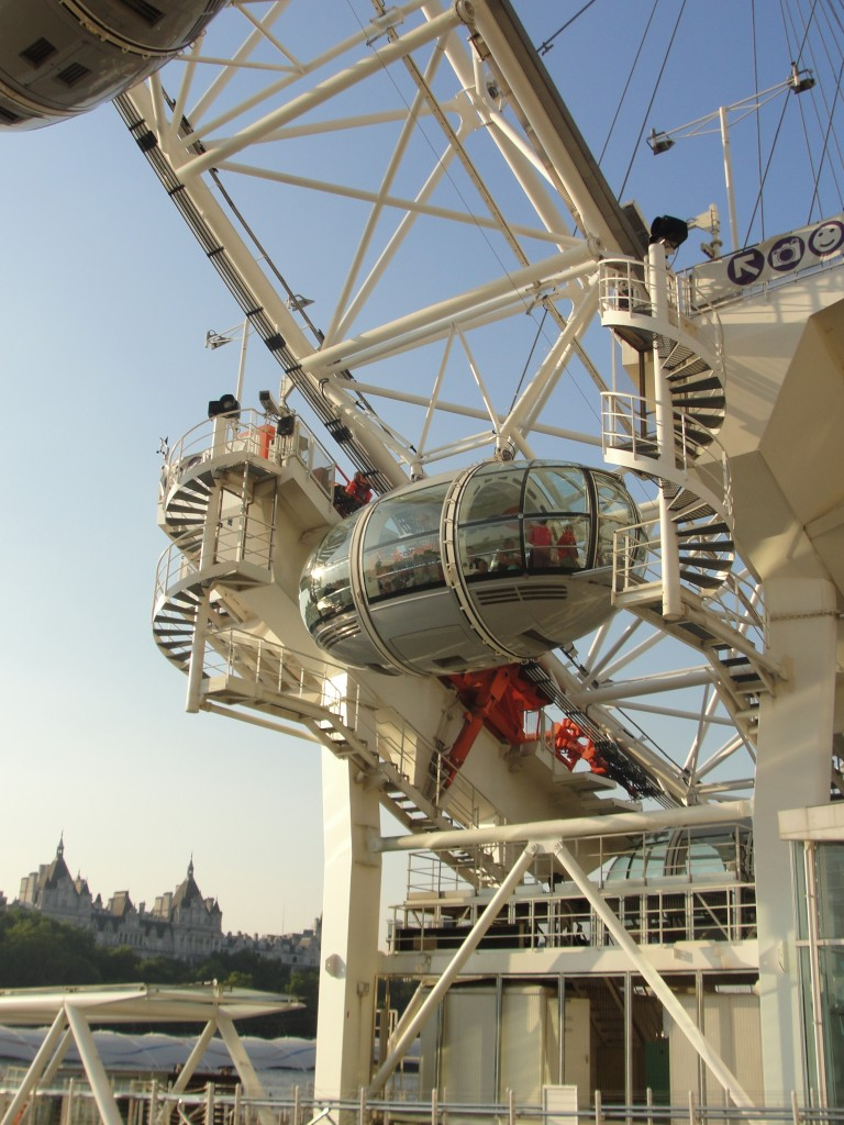 view of people standing in pod of london eye as it slowly goes up