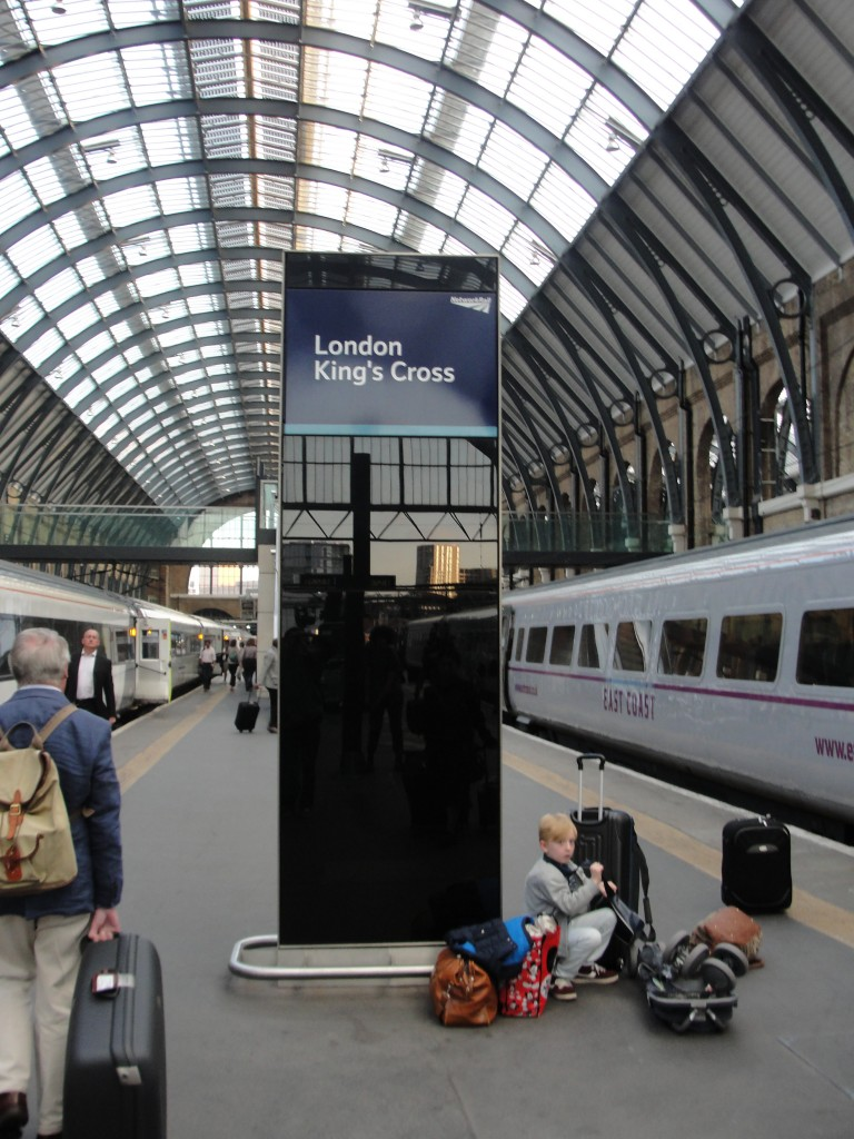 london king's cross sign on train station platform
