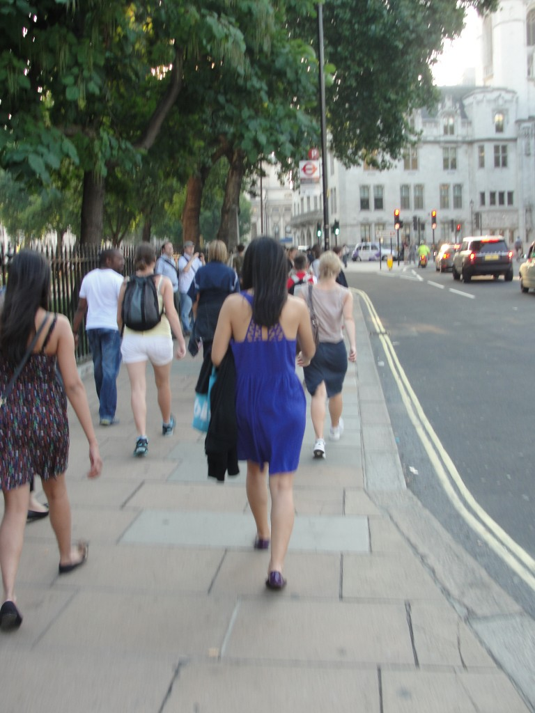 pedestrians walking on streets of london