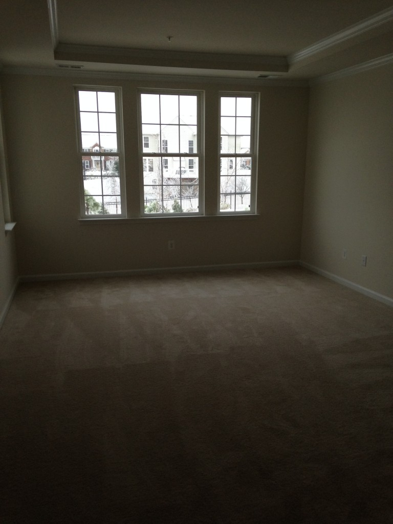 master bedroom in new condo with tray ceiling