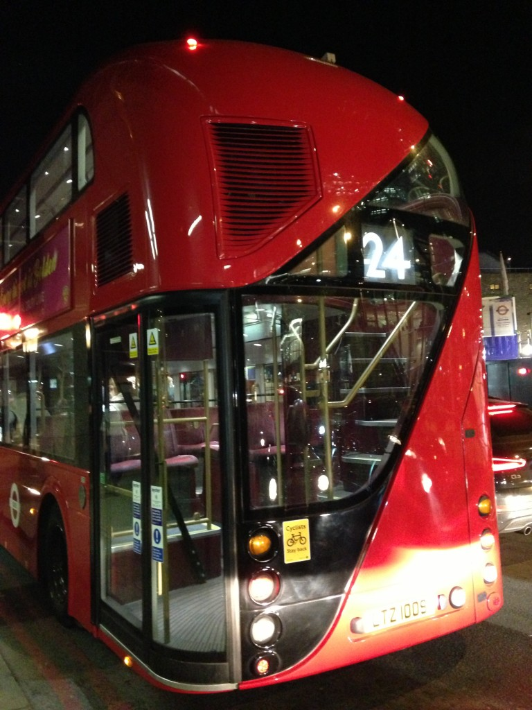 rear of modern red double decker bus in london with lots of windows