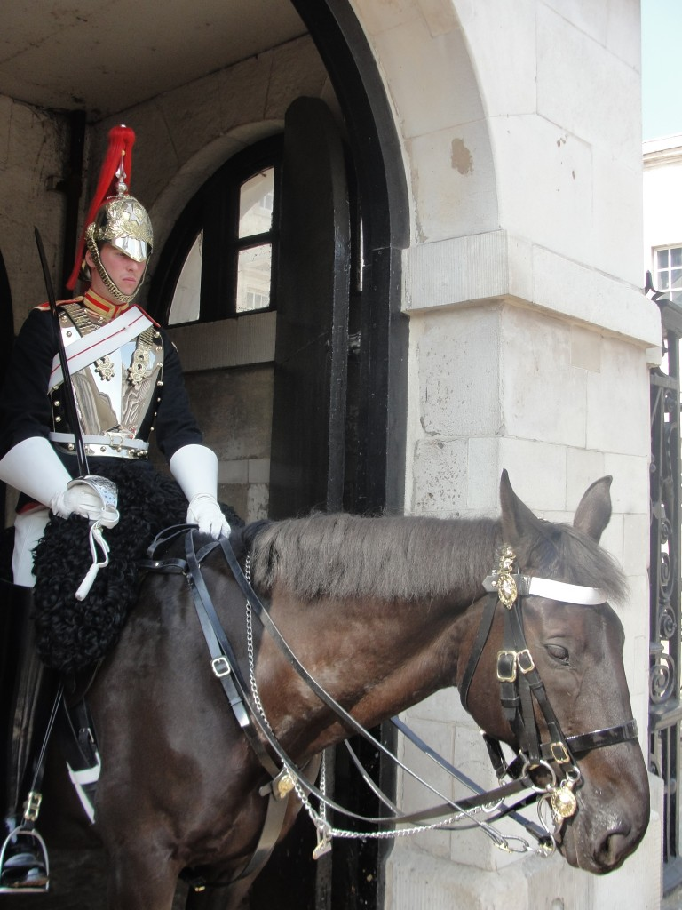 mounted guard sitting on horse guarding gate