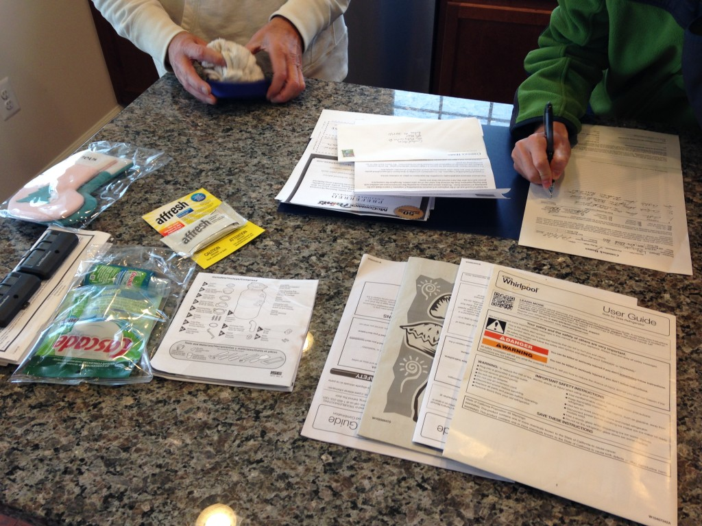 paperwork for new condo with manuals for appliances and other instructions
