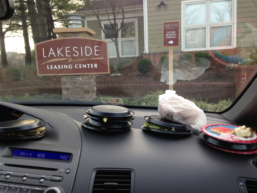 pile of plates of food sitting on dashboard of car