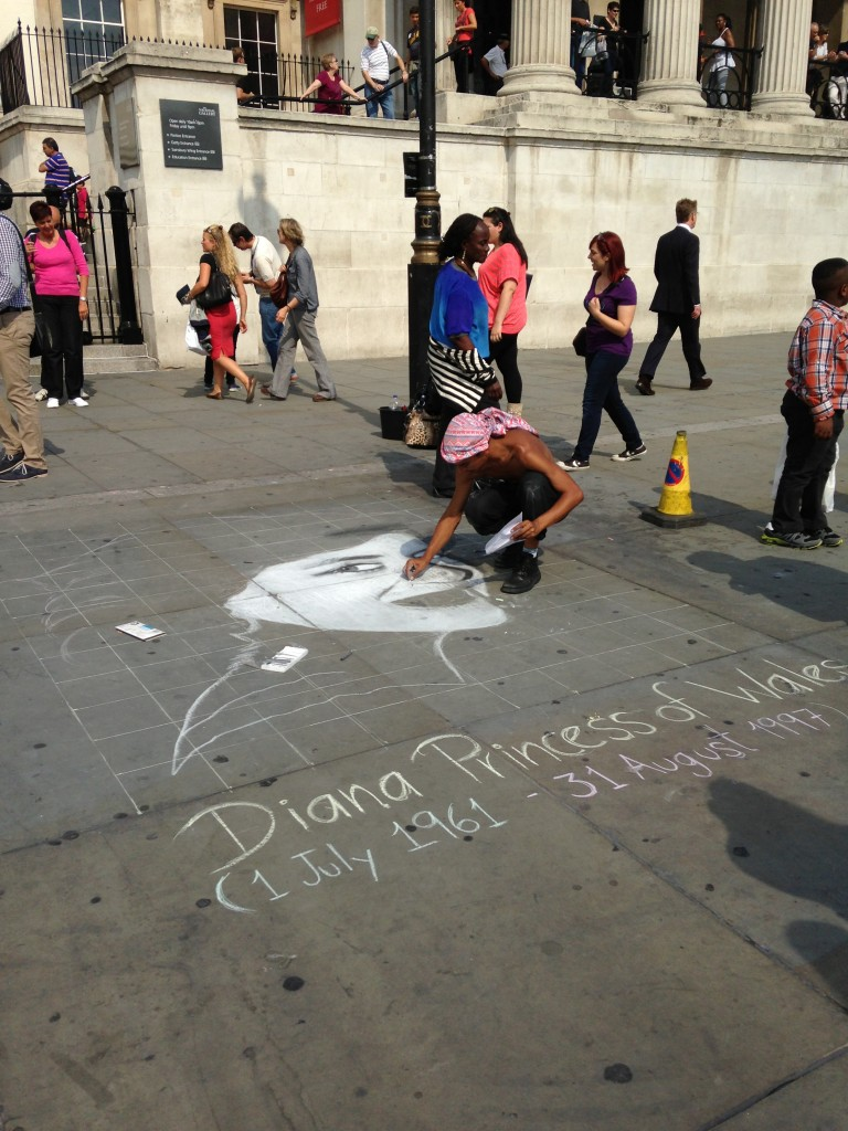sidewalk chalk artist sketching face of diana princess of wales