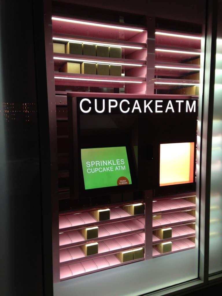 sprinkles cupcake atm machine glowing at night