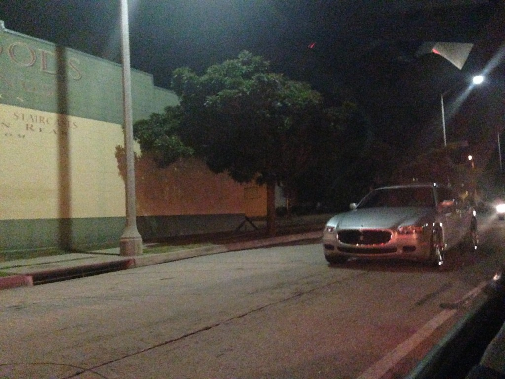 stalled maserati in middle of street turned off blocking traffic