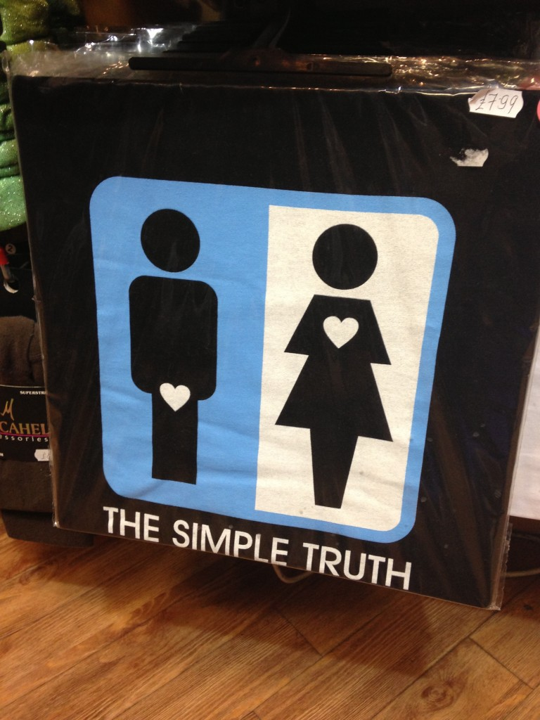 "t-shirt with image of guy with heart at crotch and girl with heart near heart and ""the simple truth"" messaging"