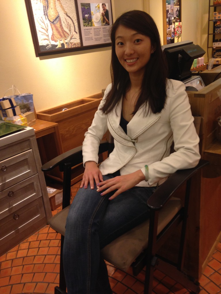 girl sitting in chair at l'occitane store waiting to receive free hand massage